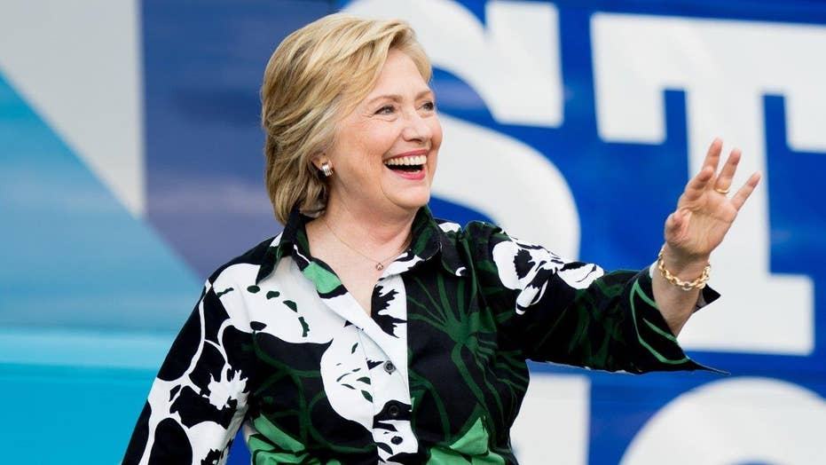 Clinton courts working class whites in Pa., Ohio