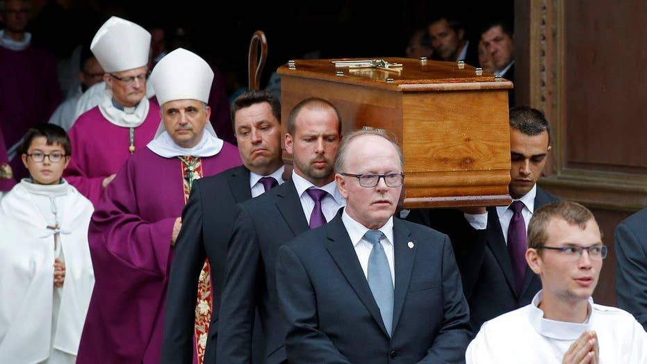 Hundreds gather to honor priest murdered in terror attack