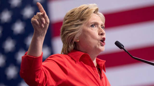 Hillary Clinton brushes off criticism from victims' families