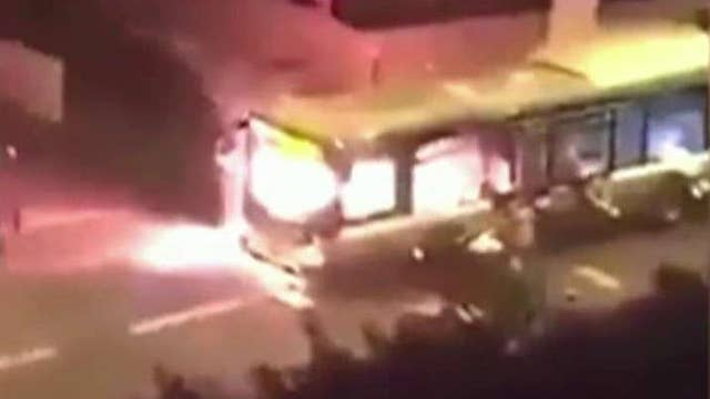 Street gang of migrants torch city bus in Paris