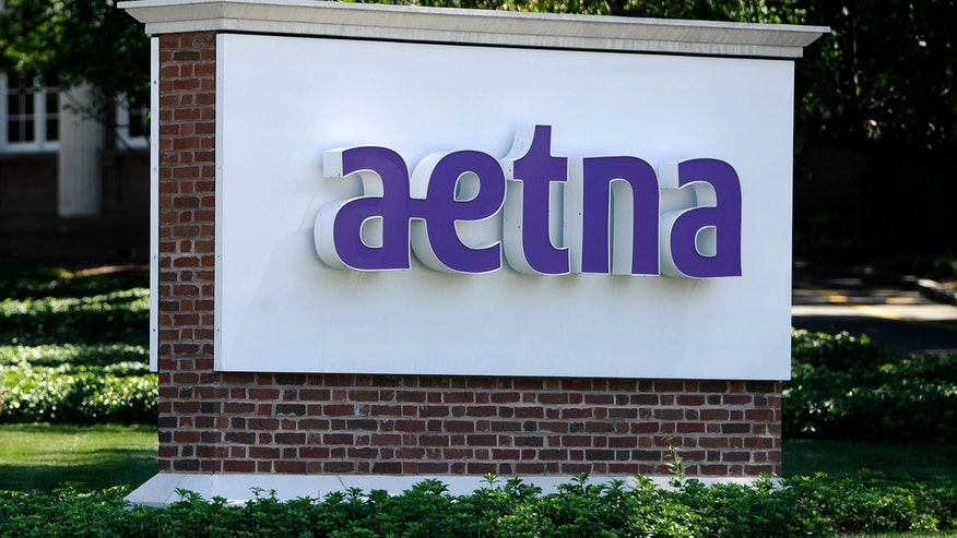 business article aetna reports loss