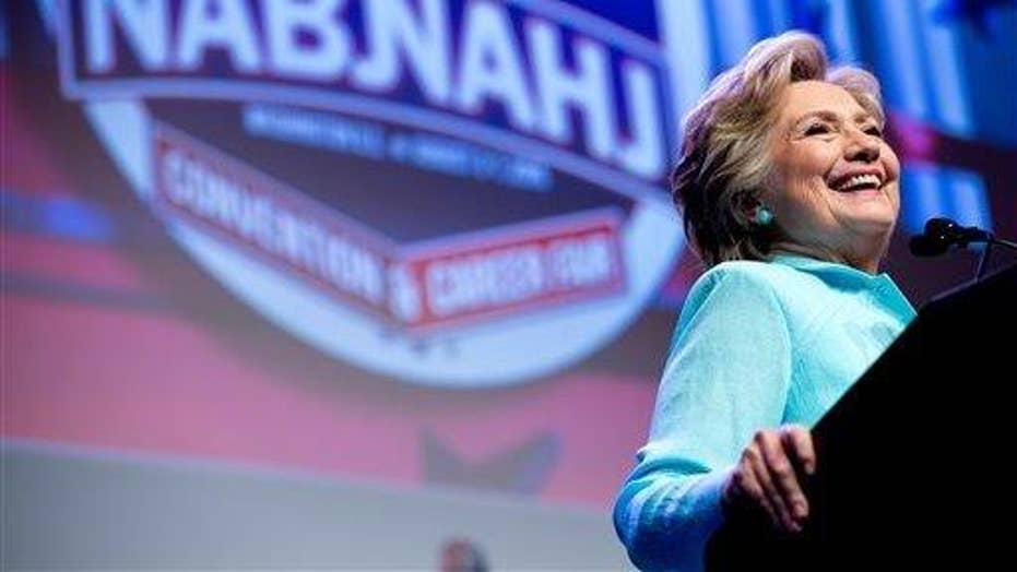 Clinton tries to clarify remarks about FBI investigation