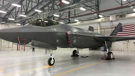Fox Firepower: Allison Barrie and 388 Fighter Wing Pilot Captain James 'Holy' Schmidt get up close and personal with the US Air Force's new F-35 fighter jet with stealth capabilities at Hill Air Force Base