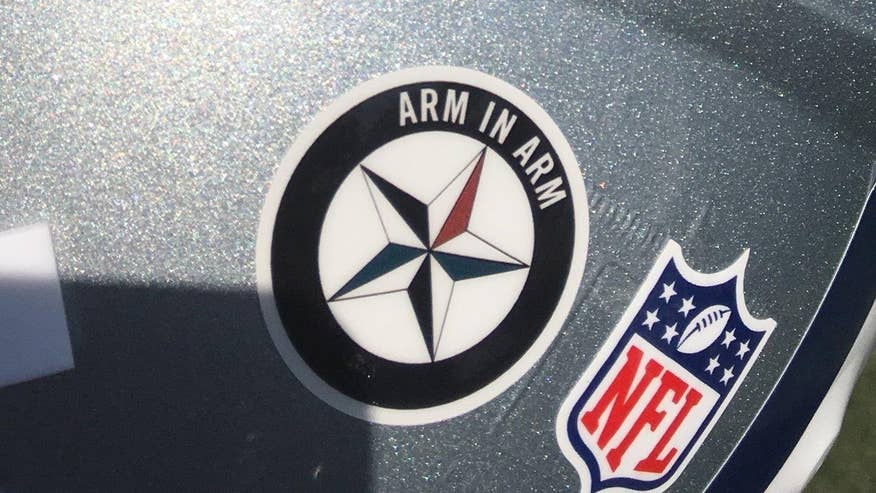 League says no to 'arm in arm' decal