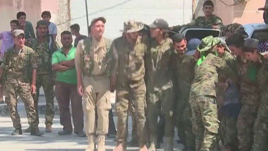 Civilians celebrate liberation of Manbij, Syria