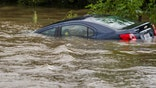 Floodwaters strand thousands, more rain expected in the coming days