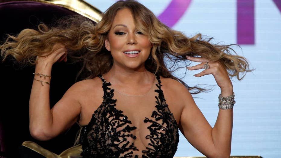 Mariah Carey billboard shows too much cleavage