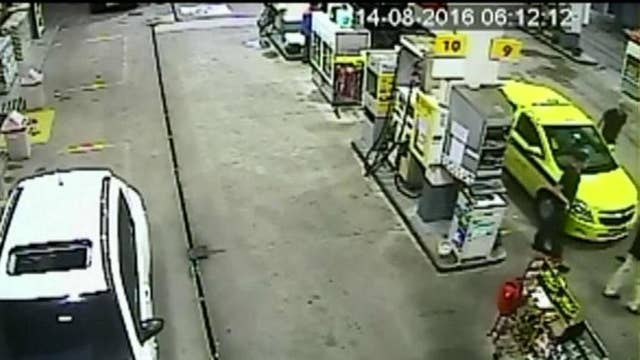 Surveillance video shows US swimmers at Rio gas station