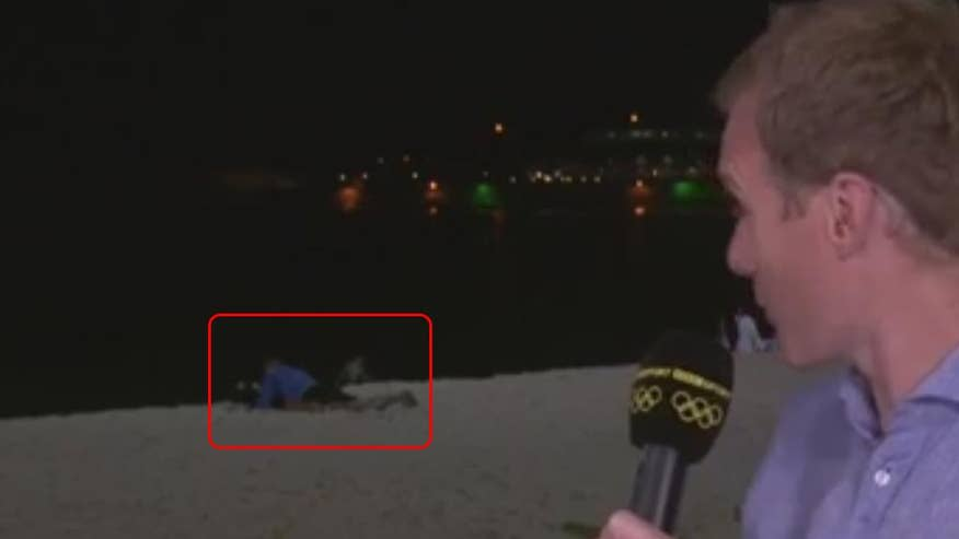 Fox411: During live broadcast, a BBC reporter catches a couple having sex on the beach. Or were they just reading a book in a particularly active fashion?