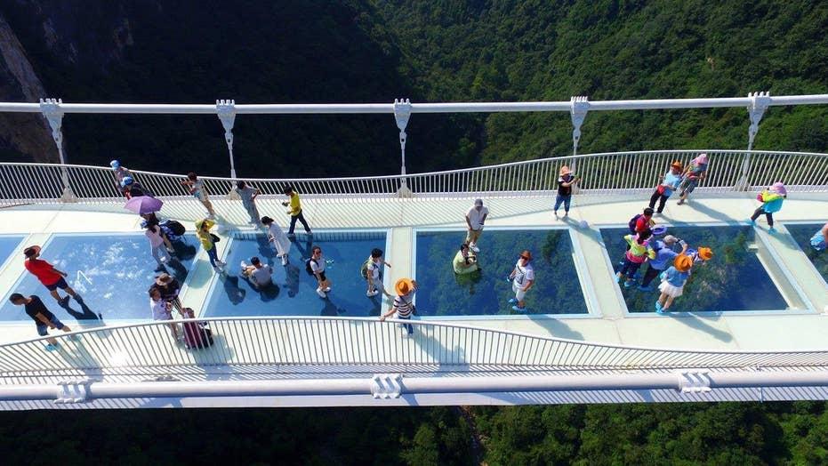 World's longest, highest glass-bottom bridge opens in China