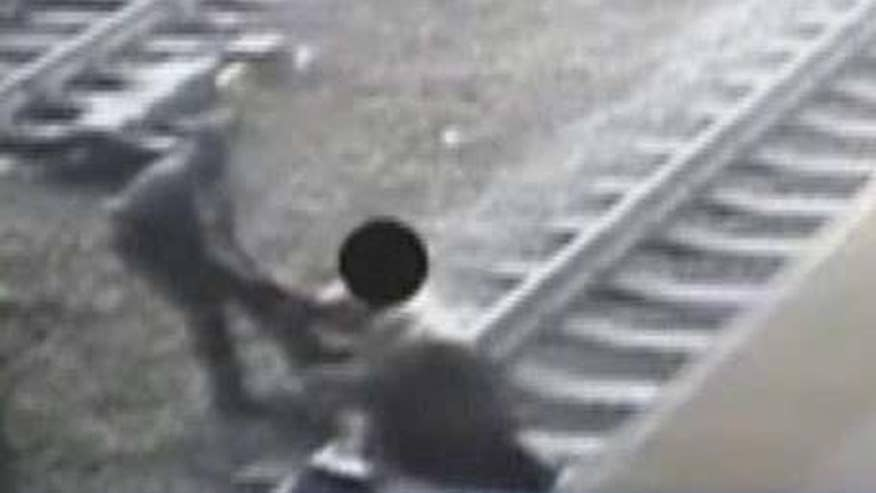 Man pulled out of the path of a commuter train