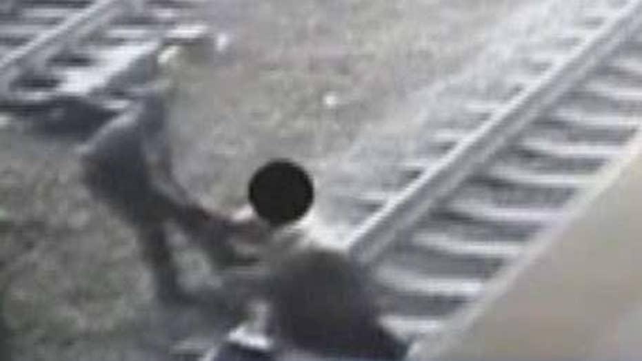 NJ Transit officer pulls man off train tracks