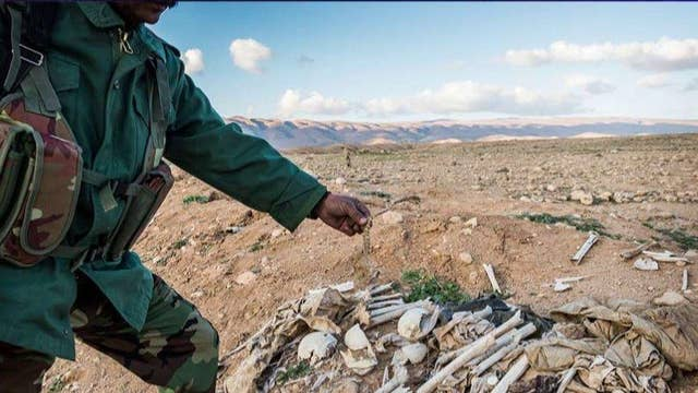 Thousands buried in at least 72 ISIS grave