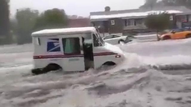 US Postal truck slammed by raging floodwaters