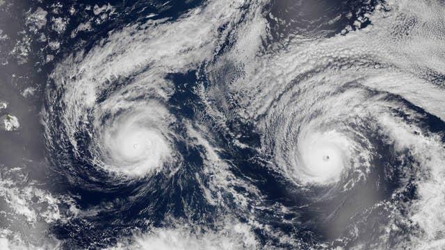 Twin storms bear down on Hawaii