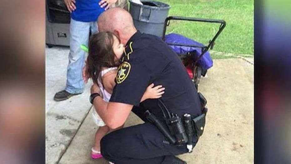 Picture of cop comforting young girl goes viral