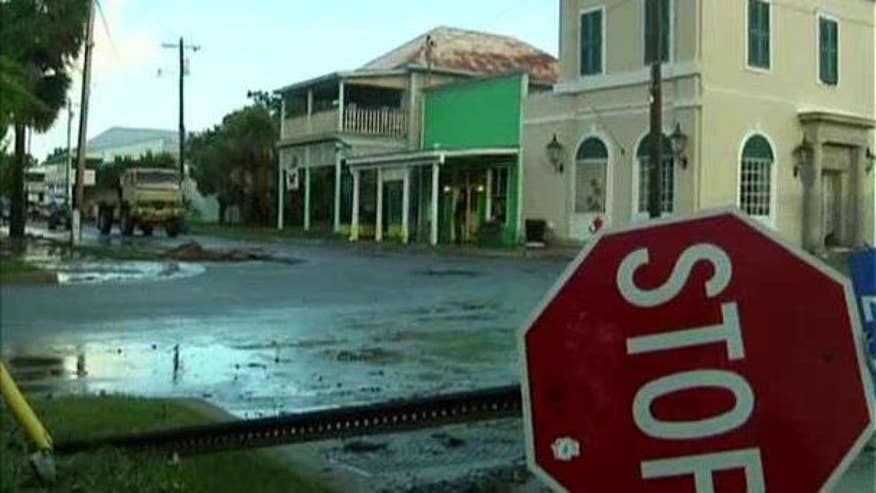 Storm leaves floods, debris in its wake