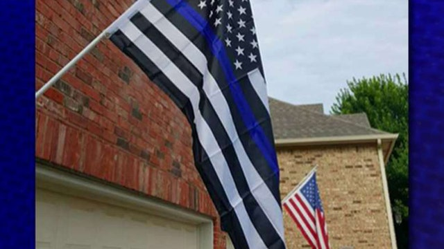 Homeowner told to remove 'offensive' pro-police flag