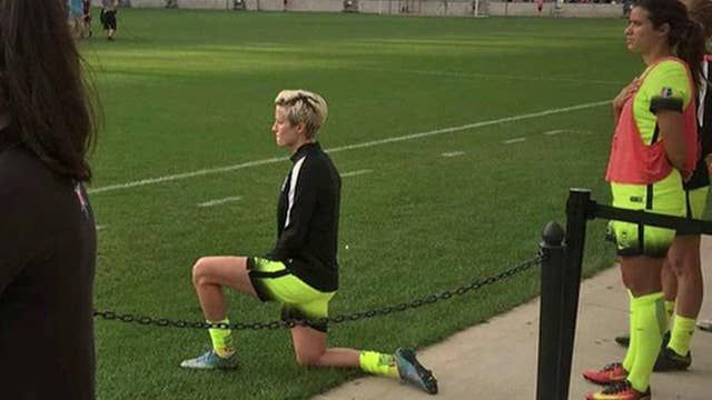 US soccer star kneels for national anthem