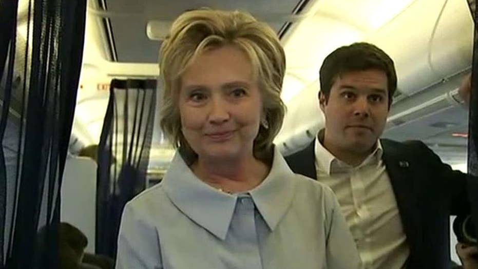 Clinton speaks to press in back of new campaign plane