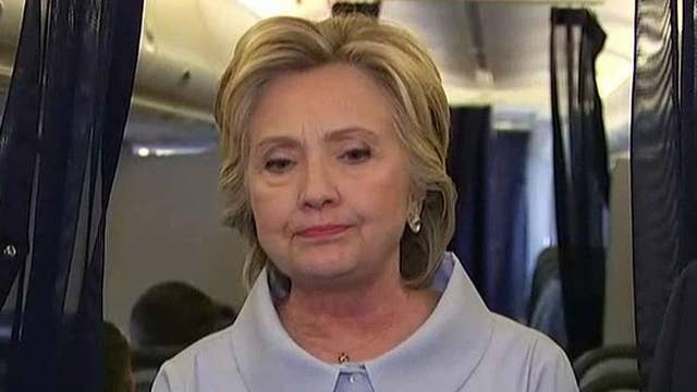 Clinton takes questions from media aboard campaign plane