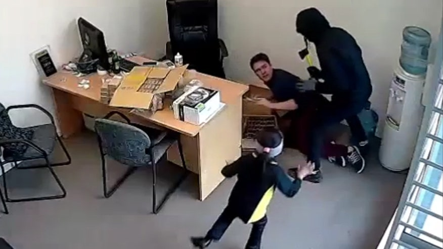 Raw video: Little girl in New Zealand confronts armed intruders who targeted her family's electronic store