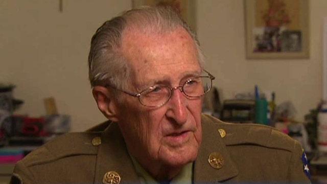 WWII veteran's caretakers steal his money