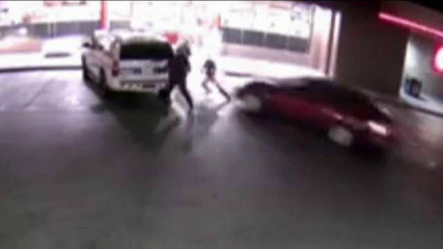 Driver slams car into 3 police officers