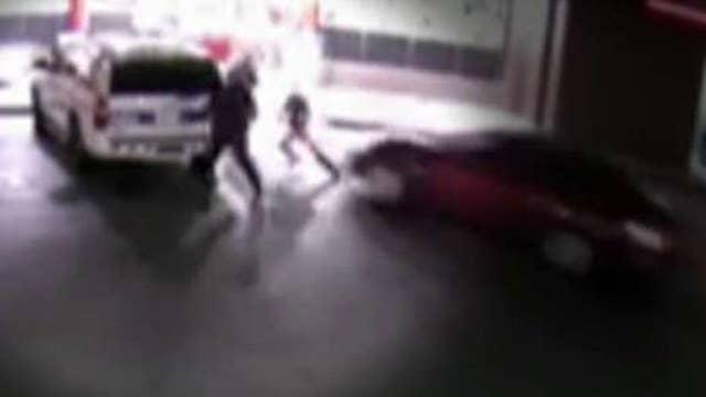 Three Phoenix police officers run down in parking lot