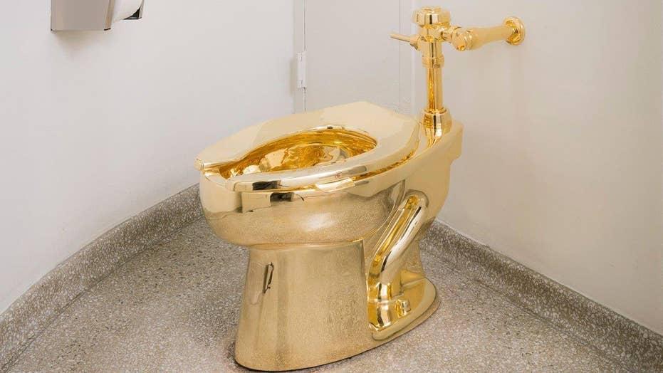 NYC museum's 18-karat golden toilet opens for business