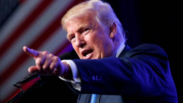 Trump scrutinized over birtherism, foundation contributions