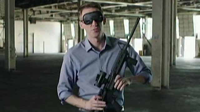 Democrat assembles rifle while blindfolded in ad