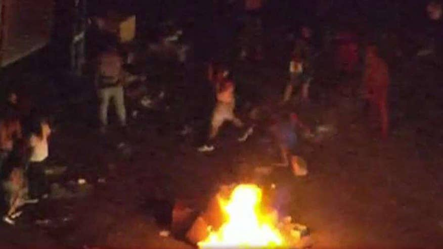 Rioters break out after police shot and killed an armed man