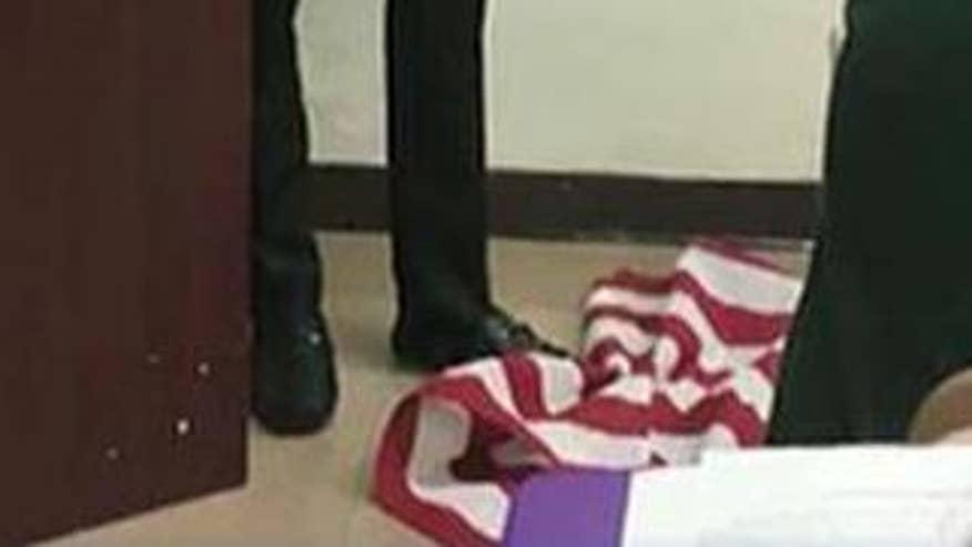 teacher stomps on flag