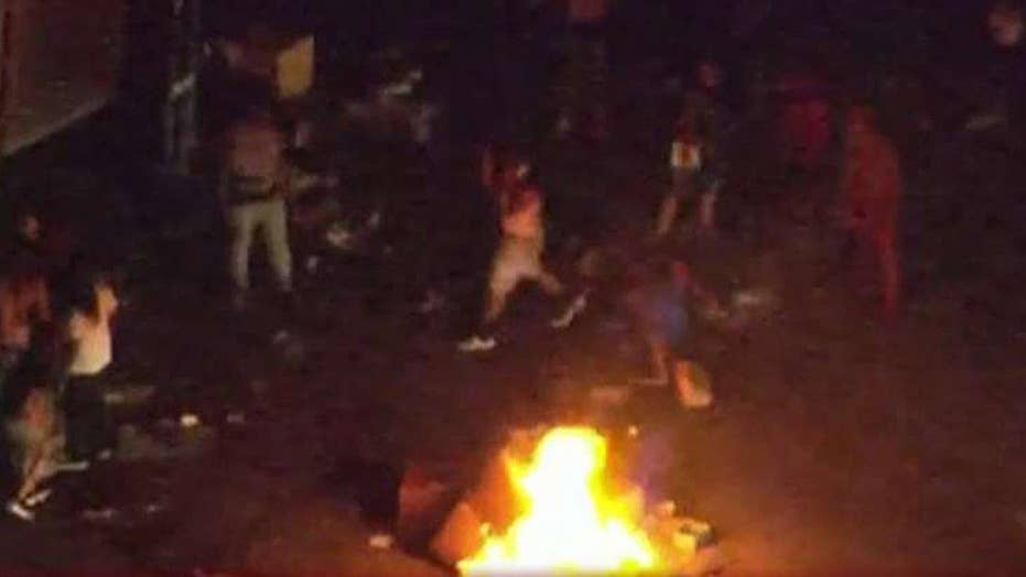 Riots break out in Charlotte following police shooting