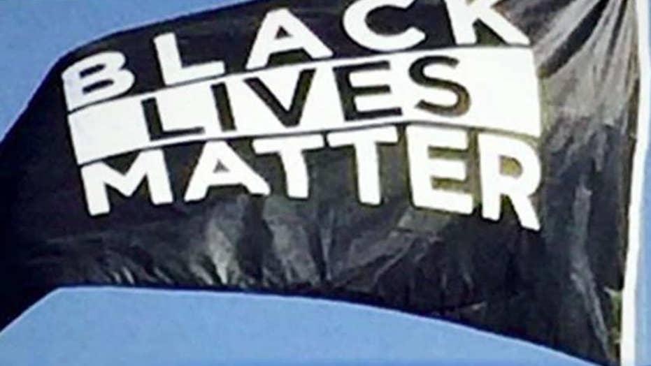 BLM flag hangs by US flag on college campus
