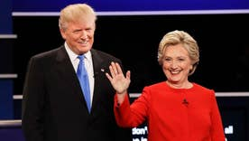 Clinton, Trump trade taunts after testy debate
