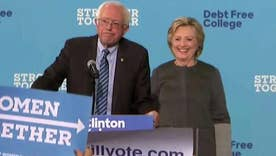Clinton brings back Sanders to help with millennium slide