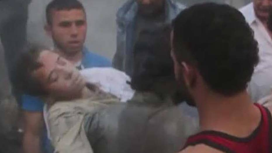 Video shows boy pulled from rubble in Aleppo