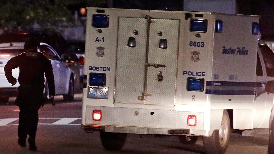 Boston police officers shot by suspect 'armed for battle'