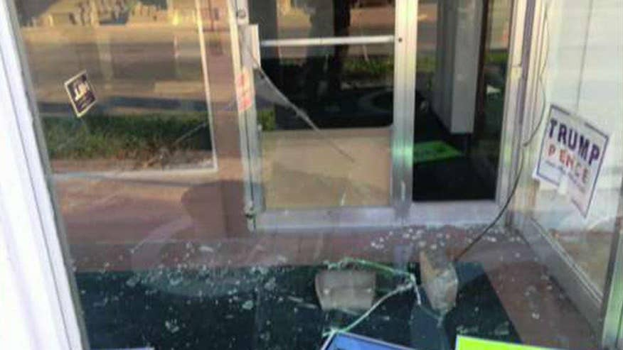Vandals shatter windows with bricks