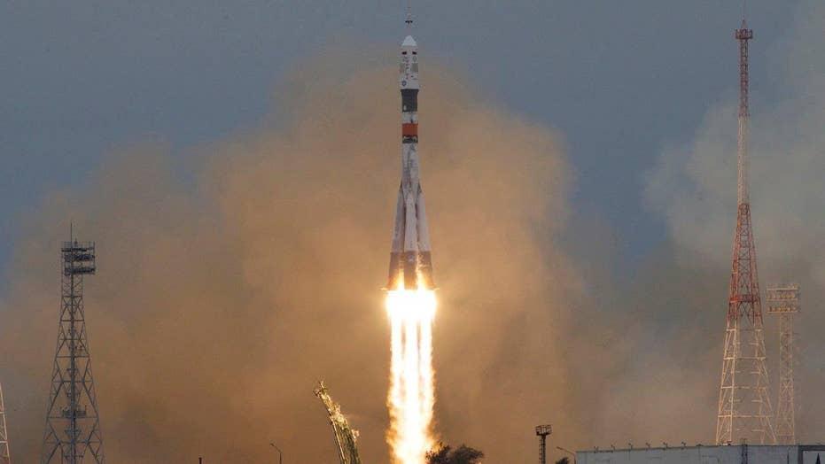 Soyuz rocket blasts off for space station