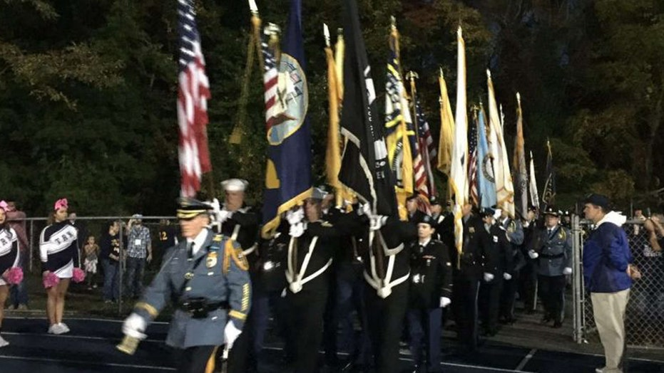 High school under fire for police, military honor ceremony