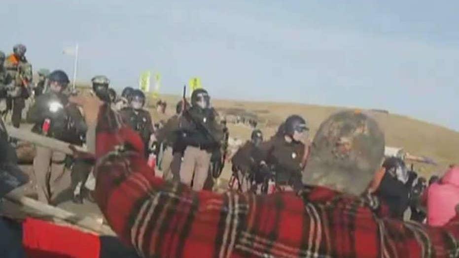 Police mace South Dakota pipeline protesters, arrest 141