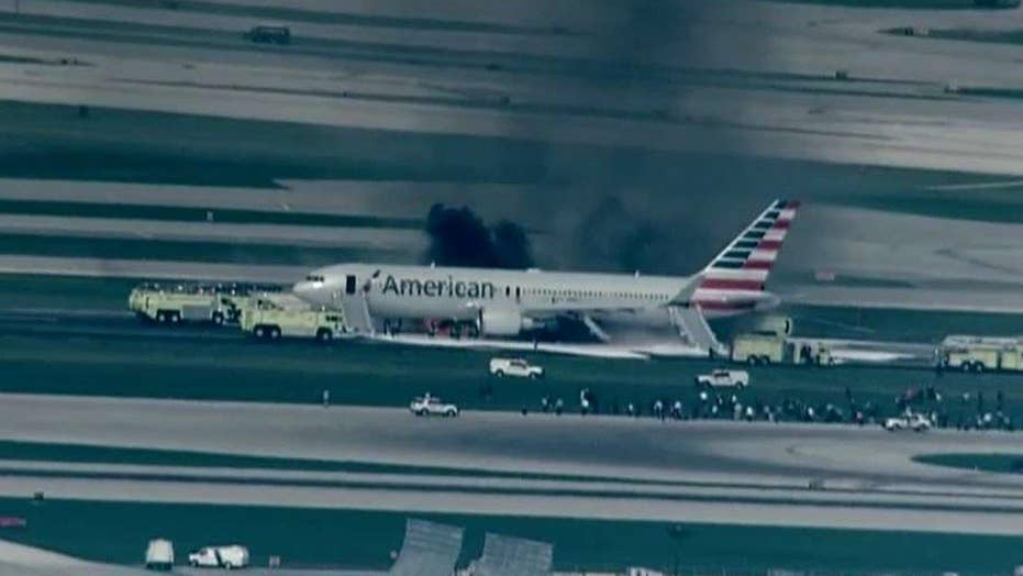 Jet blows tire, aborts takeoff, catches fire in Chicago