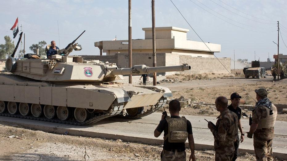 Iraqi forces break through enemy lines in Mosul