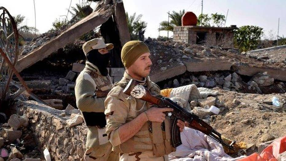 Iraqi troops push inside the city limits of Mosul