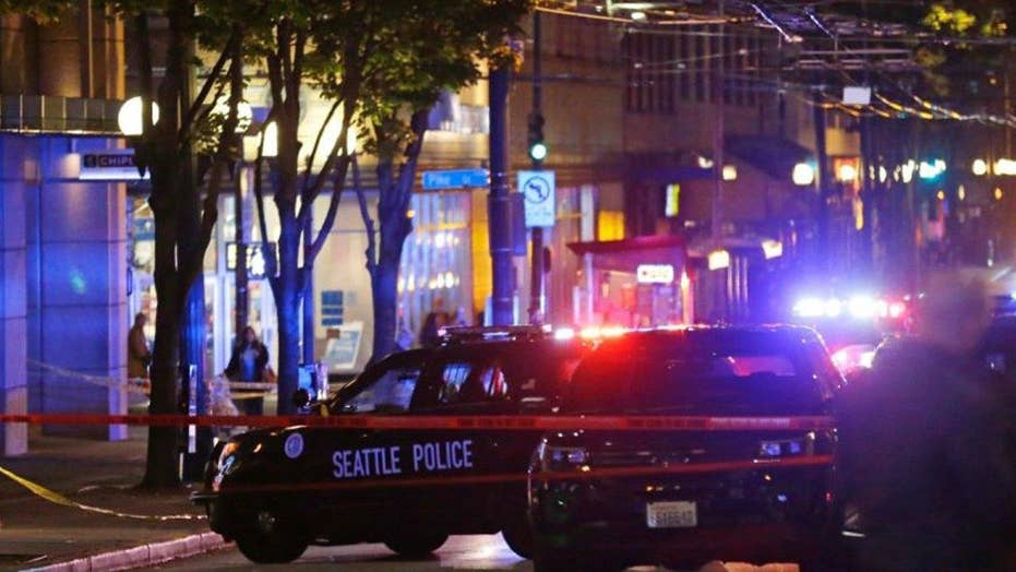 Manhunt for gunman after five shot in Seattle