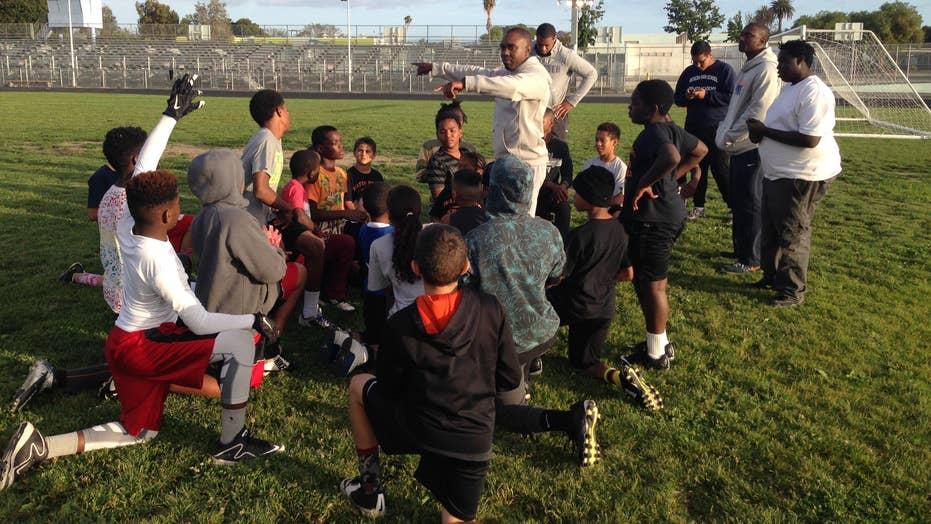 Police bridge gap with community using football program