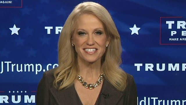 Conway fires back at protesters, transition critics